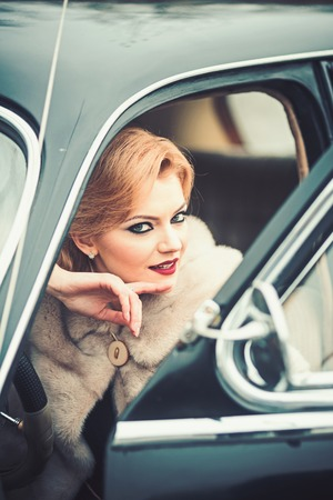 makeup of woman in retro car. makeup for sexy blond girl.