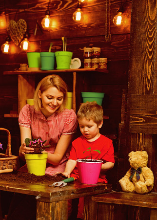 8 march concept. Little child help mother on 8 march. Mother and son potting flower for 8 march. Happy 8 march celebration
