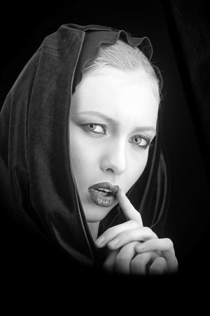 Makeup look and skincare sensual of girl. makeup and cosmetics for sensual woman in black hood.