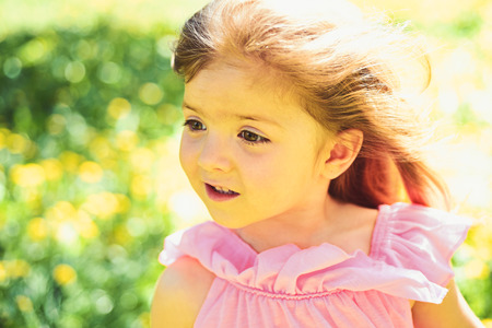 Young and carefree. face and skincare. allergy to flowers. Springtime. weather forecast. Small child. Natural beauty. Childrens day. Little girl in sunny spring. Summer girl fashion. Happy childhood Stock fotó