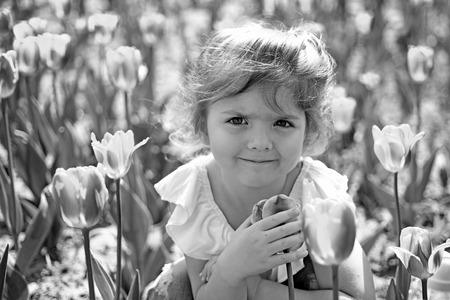 Little girl in sunny spring. Summer girl fashion. Happy childhood. face and skincare. allergy to flower. Springtime tulips. weather forecast. Small child. Natural beauty. Childrens day. Forever young.