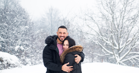 Having warm feeling and relationship. Couple in love wearing warm clothes in winter. Sensual woman and handsome man getting warm together on cold day. Couple in love hug embracing. Banco de Imagens
