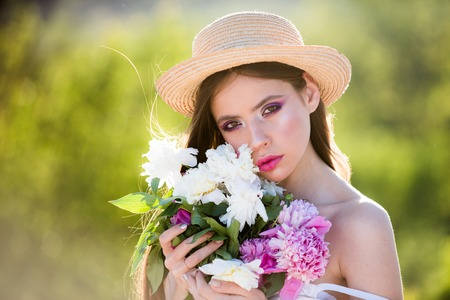 Natural beauty and spa therapy. Allergic to pollen of flowers. face and skincare. Travel in summer. Summer girl with long hair. Spring woman. Springtime and vacation. Woman with fashion makeup