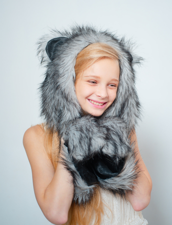 Fur Fashion. Small fashionista. Small girl wear winter hat scarf. Happy child smile in fashion style. Winter fashion trends for kids. Cosy accessory for chilly days. Beautiful Girl in Fur Hat