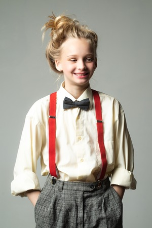 Style in action. teen girl in retro male suit. retro fashion model. vintage charleston party. vintage english style. suspender and bow tie. old fashioned child. jazz step fashion