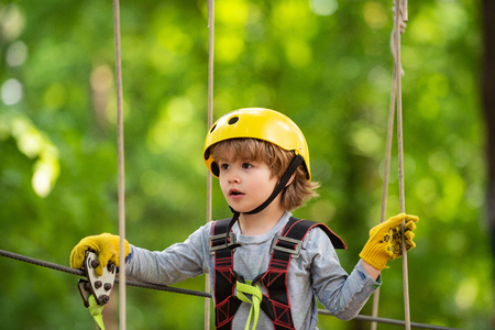 Climber child on training. Toddler age. Kids boy adventure and travel. Early childhood development. Toddler kindergarten Stock Photo