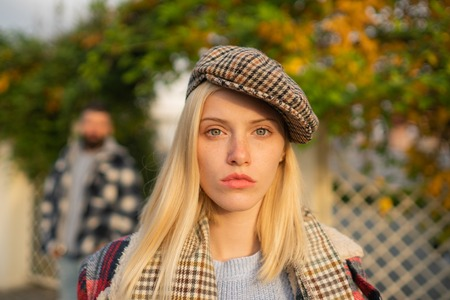 Manly world. Pretty woman in hat. Woman wear checkered clothes nature background. Girl wear kepi. Fall fashion accessory. Adorable fashion girl. Enjoy fall season. Autumn is here. Fashion trend