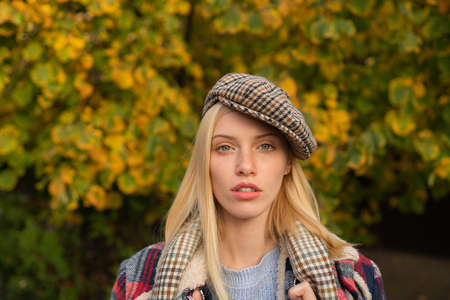 Pretty woman in hat. Fancy girl. Woman wear checkered clothes nature background. Girl wear kepi. Fall fashion accessory. Adorable blonde fashion girl. Enjoy fall season. Autumn is here. Fashion trend