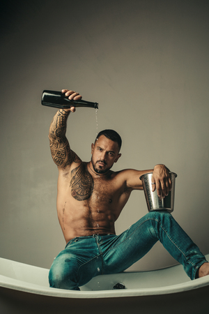 Sexy abs of man. Male fashion. Nuscular macho man with athletic body. Confidence charisma. Brutal man torso. Steroids. Alcohol drinking. Stock fotó