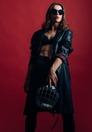 Sexy woman with American football helmet. Woman protection.
