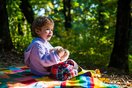Better together. Happy childhood. Inseparable with toy. Boy cute child play with teddy bear toy forest background. Child took favorite toy to nature. Picnic with teddy bear. Hiking with favorite toy Standard-Bild - 123139696