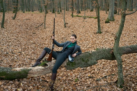 Experience and practice lend success hunting. military fashion. achievements of goals. success hunt. hunting. hunter in forest. girl with rifle. chase hunting. Gun shop. girl with weapon. Target shot