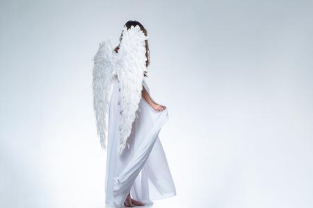 Angel girl. Long white wings. Wonderful blonde angel girl with white wings. Standard-Bild