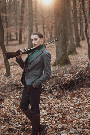 successful hunt. hunting sport. girl hunter in forest. girl with rifle. chase hunting. Gun shop. military fashion. achievements of goals. woman with weapon. Target shot. Hunting period, autumn season