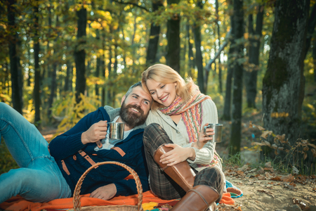 Only two of us an nature around. Tourism concept. Picnic time. Couple relaxing in park together. Romantic picnic forest. Couple in love tourists relaxing on picnic blanket. Romantic date in nature