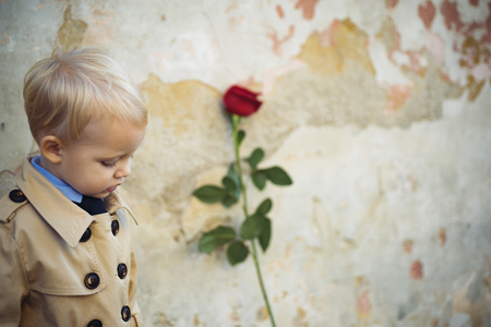 retro style. happy birthday. wedding. valentines day. romantic date. little boy in vintage coat. Beauty. small kid with red rose. happy childhood. love present. childrens day. One and only Imagens