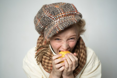 old fashioned child in beret. retro fashion model. Vintage. street kid with dirty face. vintage english style. teen girl in retro male suit. Hungry and homelss. healthy food. help each other Stockfoto