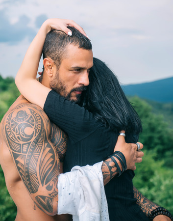 Love story. Beautiful young couple hugging. Love concept. Couple is hugging. Passion love couple. Romantic moment. Handsome muscular guy and amazing woman.