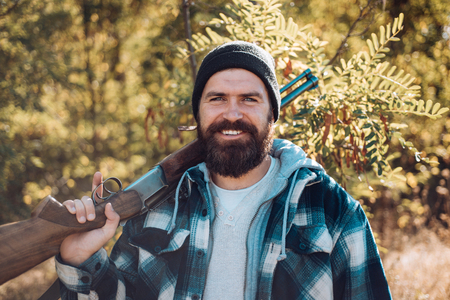 Hunter with shotgun gun on hunt. Beard and Wax. Barbershop vintage. Ideas about Barbershop and Barber salon. Stock Photo