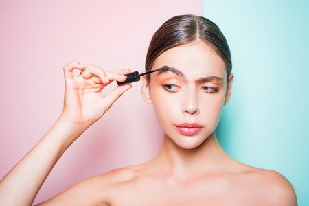 Beauty routine. Girl hold cosmetic applicator. Woman put makeup on her face. Daily makeup concept. Makeup and cosmetics. Girl healthy shiny skin put makeup on. Add more details. Fashion model 스톡 콘텐츠