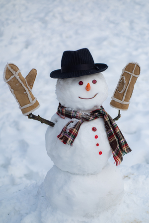 Happy winter time. Christmas snowman on white snow background. Snowman with light star in Christmas day.