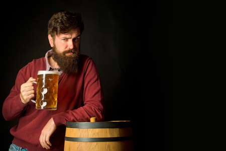 Portrait of handsome young man tasting a draft beer. Beer in Belgium. Man with beer. Equipment for the preparation of beer.