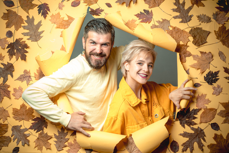 Autumn couple in autumn clothes and looks very sensually. Couple in Love wearing in fashionable seasonal clothes having Autumnal mood. Bearded man and pretty woman on yellow background for Copy space. Stok Fotoğraf