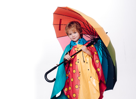 Little boy with rainbow-colored umbrella isolated on white background. Sale for entire autumn collection, incredible discounts and wonderful choice. Cute little child boy are getting ready for autumn.