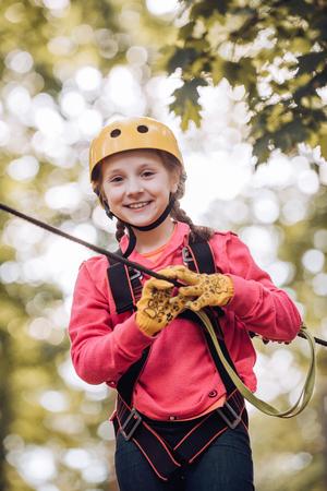Child playing on the playground. Go Ape Adventure. Child boy having fun at adventure park. Early childhood development. 版權商用圖片