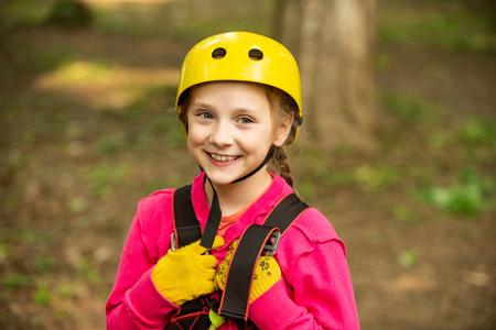 Go Ape Adventure. Child. Playground. Rope park - climbing center. Kid climbing trees in park. Climber child on training. Balance beam and rope bridges. 版權商用圖片