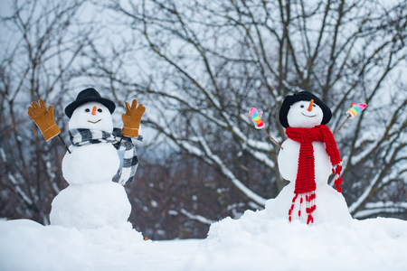 Snowman couple in love have fun Christmas or New Year. Trust in love. Enjoying nice weekend together. Romantic portrait of a sensual Snowman couple in love. Group of snowman celebrating new year. Reklamní fotografie