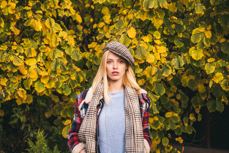 Enjoy fall season. Autumn is here. Fashion trend. Pretty woman in hat. Fancy girl. Woman wear checkered clothes nature background. Girl wear kepi. Fall fashion accessory. Adorable blonde fashion girl