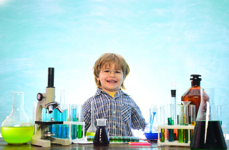 Back to school - education concet. School chemistry lessons. A chemistry demonstration. Learning at home. Lab microscope and testing tubes. What is taught in chemistry