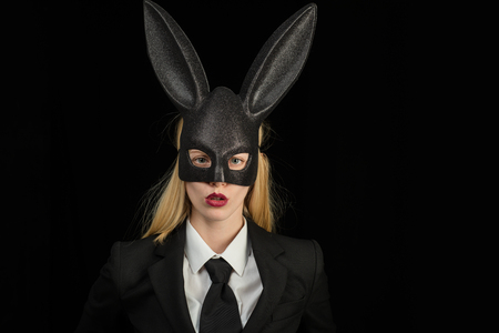 Sexy blonde girl with lace bunny ears. Beautiful woman in fashion bunny mask. Egg hunt. Rabbit woman wearing ears. Hunting eggs. Spring holiday. Rabbit and girl. Bunny mask woman. Stock Photo