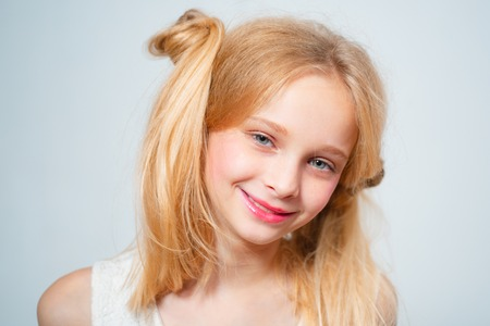 Healthy kid long hair. Retro blonde teen. Vintage. Happy blond teen. Long and healthy natural hair