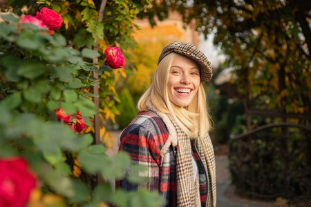 Fashion trend. Pretty woman in hat. Fancy girl. Woman wear checkered clothes nature background. Girl wear kepi. Fall fashion accessory. Adorable blonde fashion girl. Enjoy fall season. Autumn is here Stock fotó