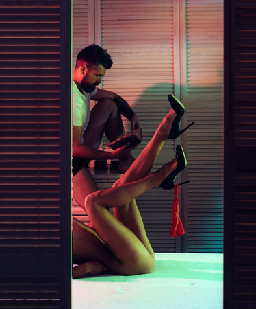 Sexy evening for young couple and protection. Love and romance. Sex games. Young lovers. Sexy couple in bed. games and relax massage. dominating relationship. Family. couple in love