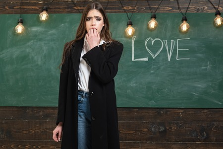 Education first. Bullied in school. Portrait of girl teenager in school. Blackboard copy space. Young student in class. First dating. Dating. Education first. Your text on Blackboard. Stockfoto