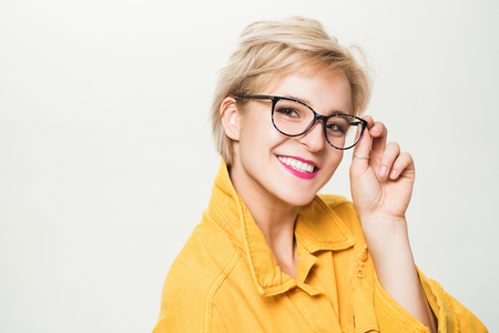 Eyesight and eye health. Good vision. Optics store. Fashionable eyeglasses. Woman smiling blonde wear eyeglasses close up. Eyewear fashion. Add smart accessory. Stylish girl with eyeglasses Фото со стока