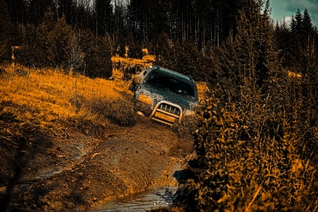 Safari suv. 4x4 travel trekking. Off road sport truck between mountains landscape. Travel concept with big 4x4 car. Road adventure. Adventure travel. Expedition offroader. Stock fotó