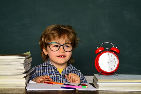 Great study achievement. Back to school. Education first. Cheerful child pupil at the blackboard. Kids from primary school. Talented child. Hard exam. Stock Photo - 125232392