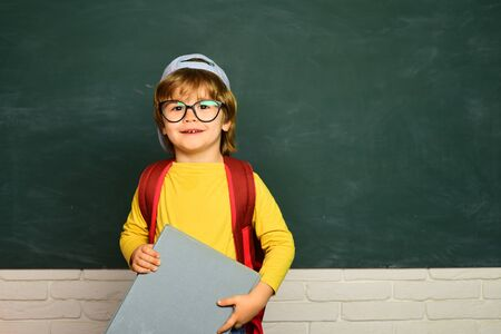 Back to school - education concet. Happy school kids. Schoolboy. Little student boy happy with an excellent mark.