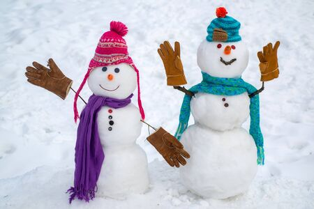 Christmas corporate party. Group of snowman celebrating new year. Passion dating and love. Portrait snowman in love. Happy funny snowman in the snow.