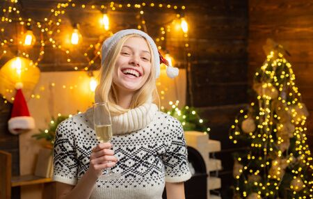 Christmas woman. Portrait of optimistic and charismatic young happy young blonde smiling and pointing. The end of the working year. Waiting for Christmas. List of goals in the new year. Tracker mood.