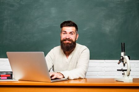 Bearded tutor near chalkboard. Student Studying Hard Exam. Teachers day. Tutor. Science and education concept. School day. Education.