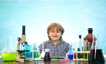 They carried out a new experiment in chemistry. Science and education concept. Science. Happy little scientist making experiment with test tube. Knowledge day Banco de Imagens