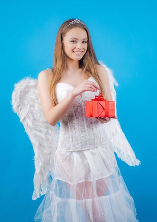 Cupid in valentine day. Beauty blue her eyes - charming lady with feather wings. Lovely girl. Angel in love present gift. Lovely girl cupid with bow and arrow is ready to find your love.