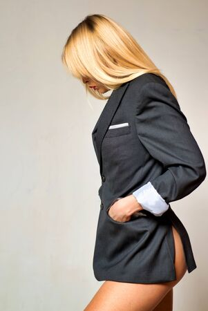 Sexy female receptionist. Attractive blonde with bare legs in mans jacket. Sexy school uniform.