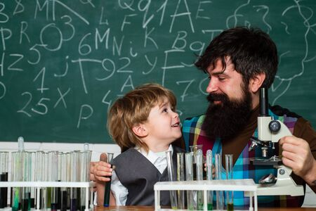 Back to school - education concet. Child and teacher in the class room. Back to school and home schooling. Back to school and Education concept. Banco de Imagens