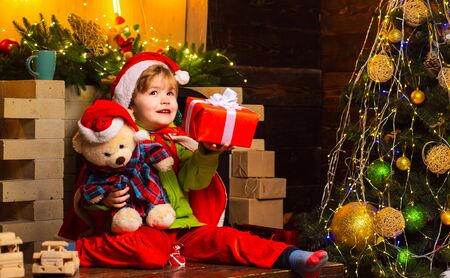 Dreamy baby toddler on christmas eve. Believe in christmas miracle. Wish to meet santa claus. Winter holidays. Merry christmas and happy new year. Happy childhood. Adorable child play at home Фото со стока